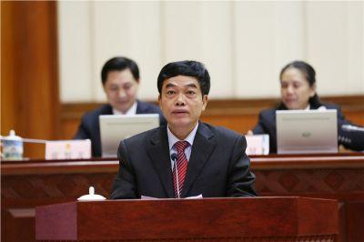 刘耀龙作《关于修改<广西壮族自治区人口和计划生育条例>的决定(草案)》审议结果的报告