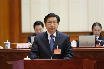 黄日波作《关于修改<广西壮族自治区人口和计划生育条例>的决定(草案)》的说明