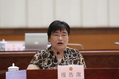 谭和平作关于《广西壮族自治区司法鉴定条例(草案)》的审议报告