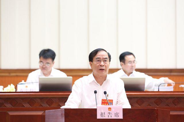 李国坚作关于《广西壮族自治区投资促进条例(草案)》审议结果的报告